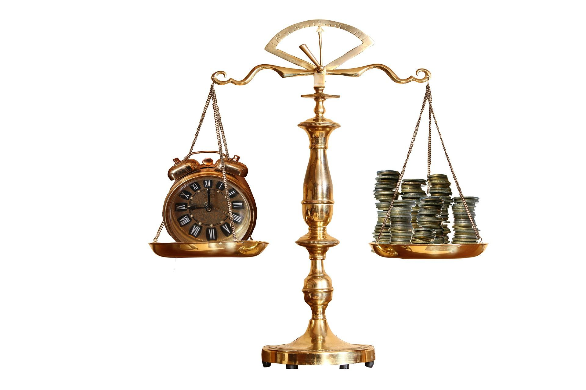 scales of justice and money